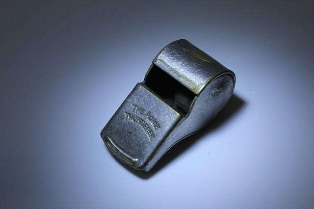 An old metal whistle | Career Coach