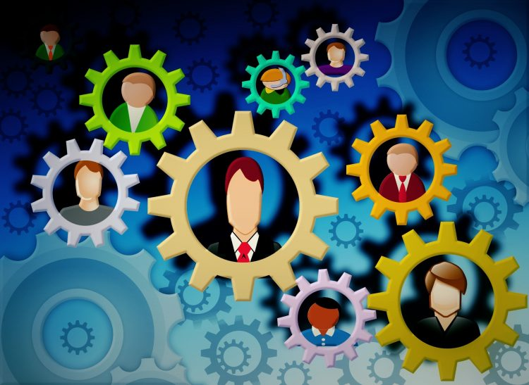 Multi colored gears with different workers inside of the gears | family business HR issues