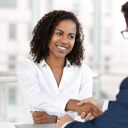 Labor relations consultant shaking hands with a client